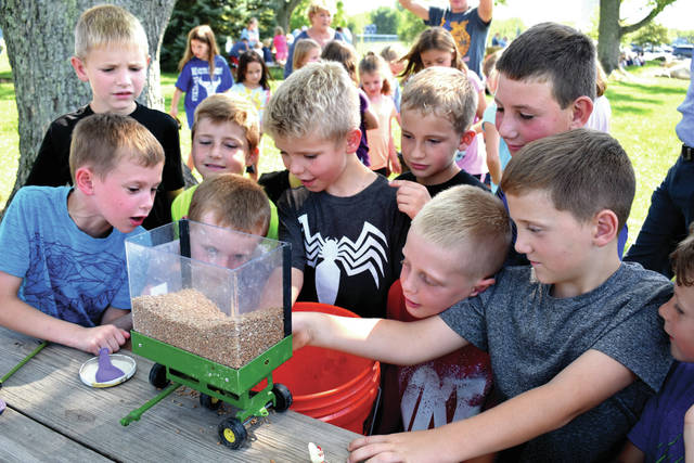 Cody Willoughby | Troy Daily News Second grade boys at Miami East Elementary School engage in grain safety activities on Tuesday during Farm Safety Week, which runs in the district through Friday.