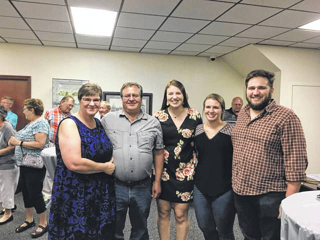 Courtesy of Heritage Ohio | Facebook Mainstreet Piqua Executive Director Lorna Swisher, left, celebrates the 25th anniversary of Mainstreet Piqua with her family during a celebration dinner on Tuesday evening.