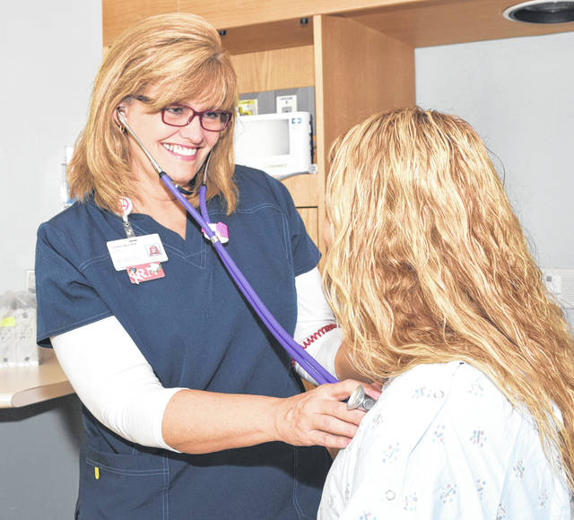 "Provided photo Sharon Poeppelman, a nurse at Upper Valley Medical Center as well as a breast cancer survivor, advises patients to ""be diligent"" about their health despite busy schedules."