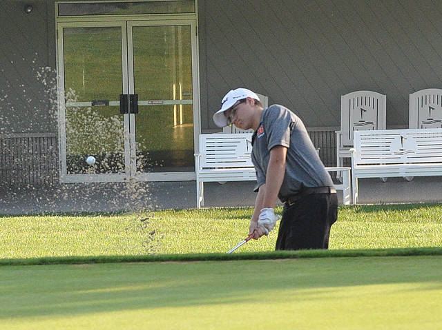 Rob Kiser/Call Photo Bradford's Keaton Mead blasts out of a bunker on the ninth hole Thursday at the CCC tournament.