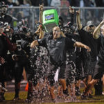 Covington football holds off Miami East in epic battle