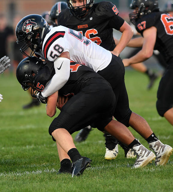 Ben Robinson/GoBuccs.com Covington's Jesse Fisher sacks Minster quarterback Jacob Niemeyer.