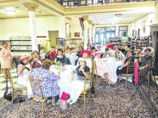 """Provided photo On Sept. 9, Mary Frances Rodriguez of Design52 Creative Services partnered with the Piqua Public Library to host """"A Proper Afternoon Tea"""" for 24 guests. Library Director Jim Oda servevd as """"butler"""" for the event."""