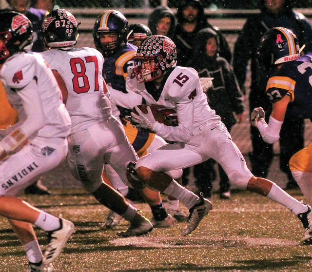 Piqua's Owen Toopes follows Grant Toopes (87) block on a kickoff return Friday night.
