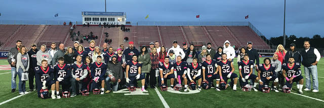 Piqua senior football players and their parents gather on Purk Field for a grou photo at the conclusion of Friday's Senior Night events.