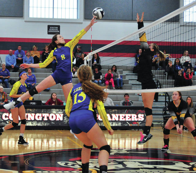 Lehman Catholic's Olivia Lucia taps the ball over the net against Botkins Saturday at Covington.