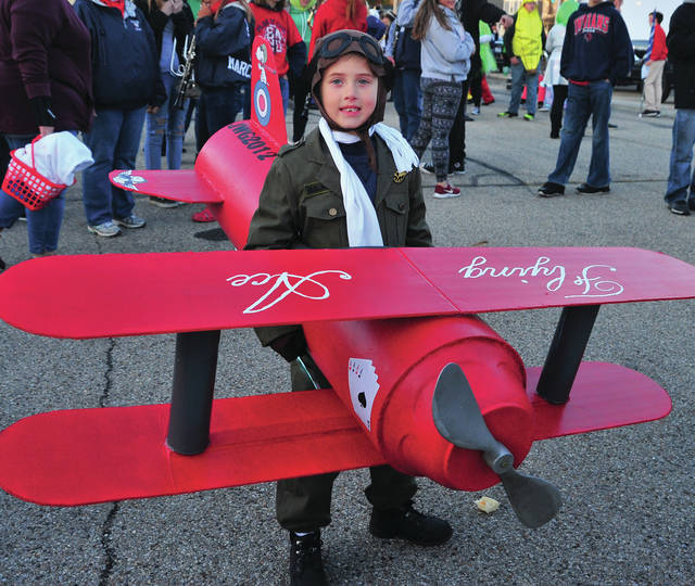Jackson Gray, 6, of Fletcher brings Flying Aces back to life at Wednesday's Kiwanis Halloween Parade.