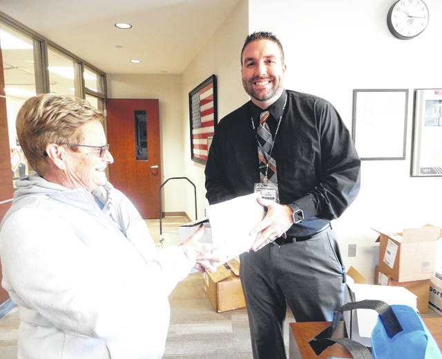 Provided photo On behalf of WOW, Women of Westminster Presbyterian Church, Piqua, Nancyʁllen presented Piqua Central Intermediate School Principal Josh Kauffman with dry erase markers and earbuds. The Presbyterian women's group has adopted the school as one of their mission projects and periodically donates needed supplies for the students.