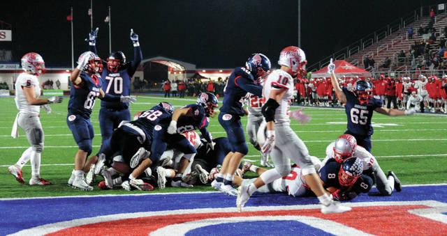 Jarrell Lewis, 8, scores for the Indians during Friday's U.S. Marine Corps Great Rivalry Series game against Troy.