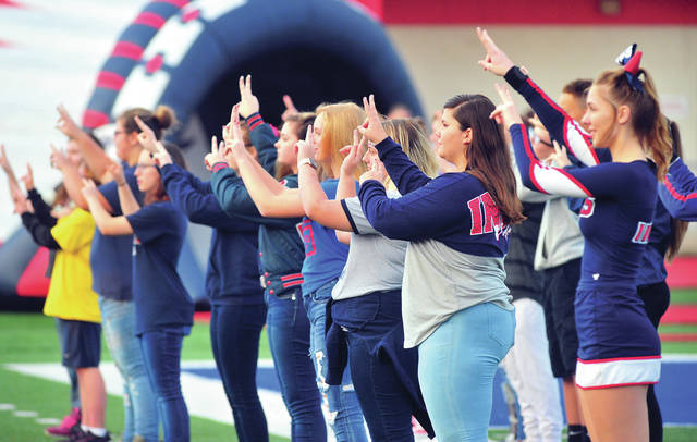 Mike Ullery | Daily Call The Piqua High School American Sign Language class signs the Star Spangled Banner during pregame of Friday's game against Greenville at Alexander Stadium/Purk Field.