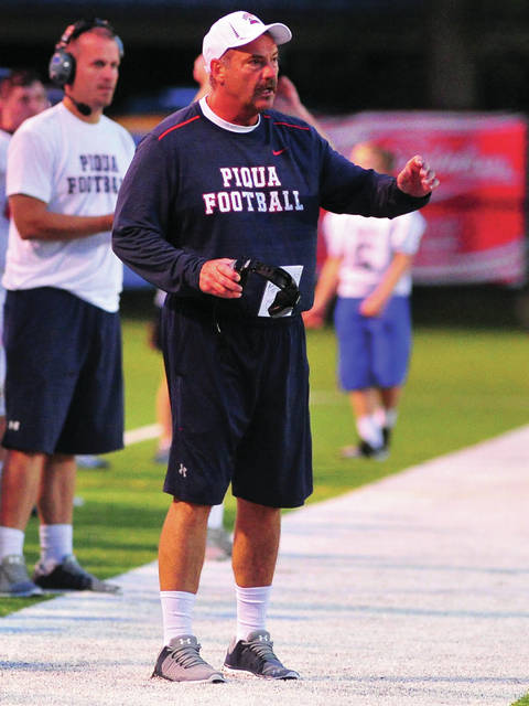 Mike Ullery|Call File Photo Piqua football coach Bill Nees directs the team to a win over Greenville last year.