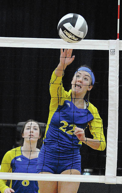 Rob Kiser|Call Photo Lehman Catholic's Reese Geise tips the ball over the net Monday night against Ansonia.