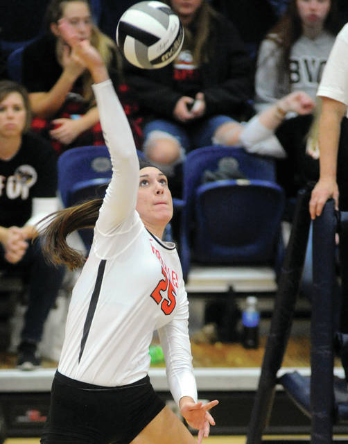 Versailles Lindsey Winner takes a big swing against Miami East Thursday night at Trent Arena.