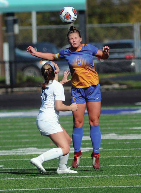 Lehman Catholic's Grace Monnins nails a header against CCD's Alexandra Vredevel Saturday at Xenia.