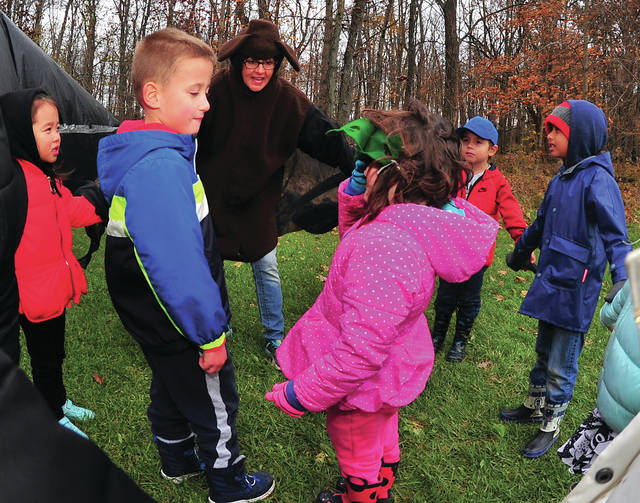 Mike Ullery | Daily Call Miami County Park District Naturalist Marj Gaskell talks about bats with kindergarten students from Concord Elementary School in Troy during a field trip to Stillwater Prairie on Tuesday.