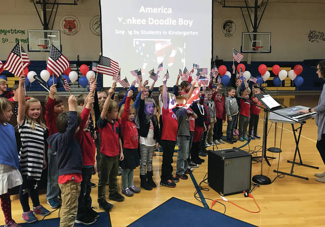 Mike Ullery | Daily Call Kindergarten students from both A.M. and P.M. classes sing America and Yankee Doodle Boy during Wednesday's Russia Local Schools Salute to Veterans at the school gym.