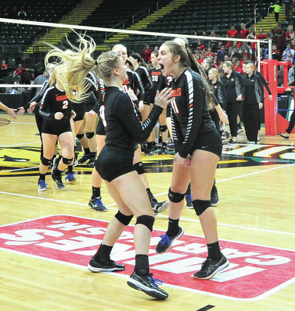 Alexa Didler, 9, and Abby Stamen, 11, celebrate a Division III state semifinal voll eyball win over Tuscarawas Valley in three straight sets at the Nutter Center on Thursday.