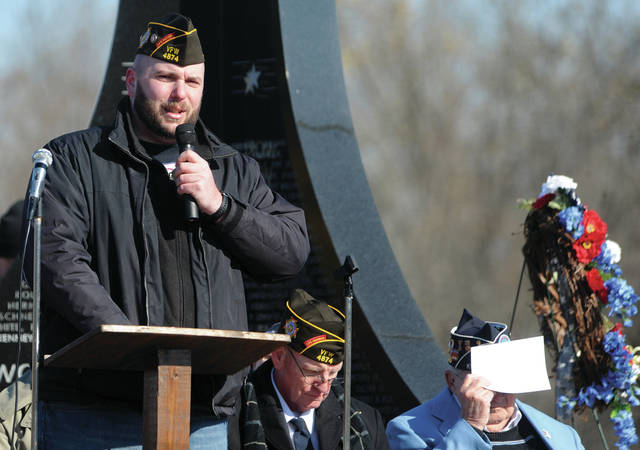 Jim Harter, a United States Marine Corps veteran, delivers the Veterans Day keynote address during Sunday's Piqua Veterans Day Ceremony at the Veterans Memorial. Harter, who resides in Sidney, served tours in Iraq and Afghanistan and is currently post xommander of VFW Post 4874.