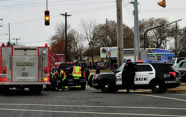 Mike Ullery   Daily Call Piqua firefighters, medics, and police work at the scene of a two-car crash on South Street at McKinley on Wednesday afternoon. A total of four victims were transported to the hospital by Piqua Fire Department medics. None of the injuries is believed to be serious.