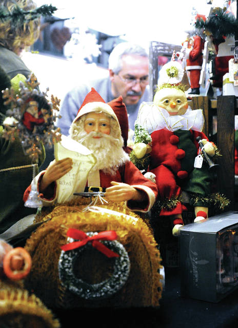 Mike Ullery | Daily Call Rob and Julie Morrison of Troy check out the Christmas decorations at Apple Tree Gallery in Piqua on Saturday.