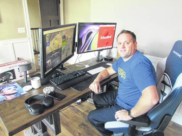 Josh Brown| Miami Valley Today Loaded CEO Brandon Freytag sits in his office at his home in Troy watching a few video game streamers that his company represents.