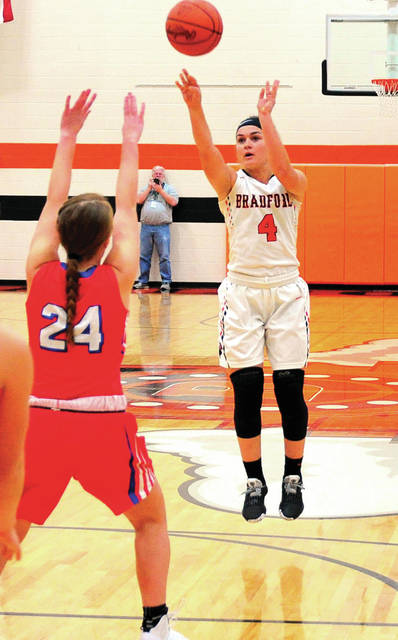 Bradford's Austy Miller shoots over Tri-Village's Andi Bietry Thursday night.