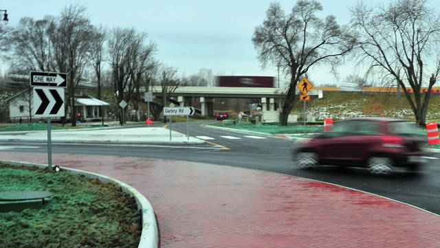 The roundabout at the intersection of Looney and Garbry Road opened to traffic on Thursday morning.