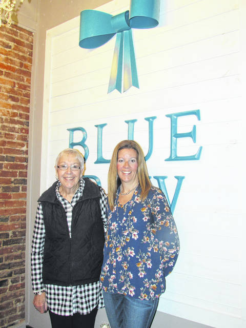Sam Wildow | Daily Call Heather Maxwell, right, owner of Blue Bow Boutique, with her mother Judy Favorite, who will help operate the Piqua location of the Blue Bow Boutique at 325 N. Main St.