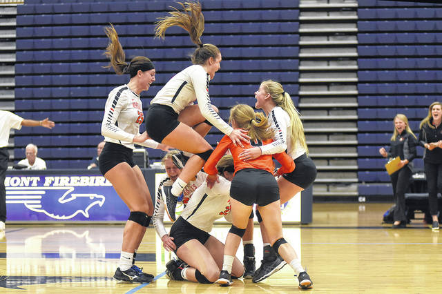 Dale Barger|Aim Media Versailles celebrates after defeating Marion Pleasant in the regional finals Saturday.