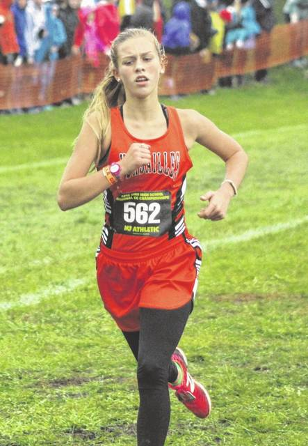 Aim Media Photo Versailles and Madelyn Holzapfel will run at the state meet Saturday