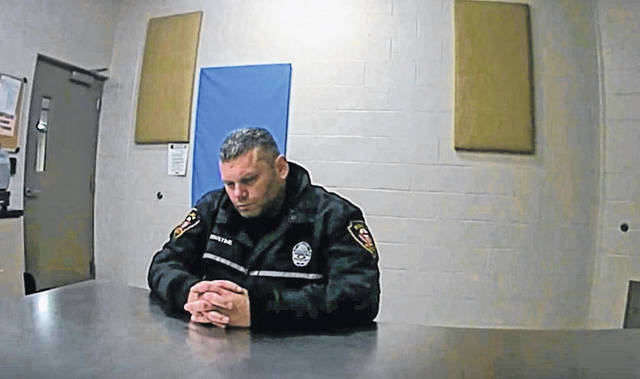 Courtesy of the Piqua Police Department Piqua police officer Justin Augustine gets processed for an OVI charge on Oct. 27, after wrecking a patrol cruiser while on duty.