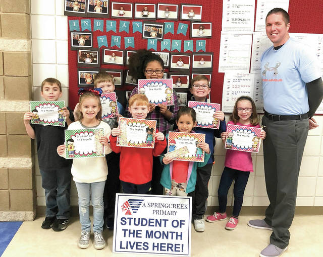 Provided photo Springcreek Primary School Principal Ross Loudenback stands with the school's Students of the Month for November. Shown left to right, are, front row: Aryana Force, Owen Schulz, Aleigha Martinez; back row: Gabe Mackeller, Brayden Venrick, Maya Oduro, Levi Frost, Judah Frost.