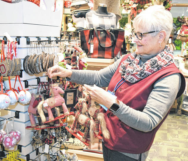 Provided photo Upper Valley Medical Center volunteer Connie Gillespey arranges holiday items in the hospital gift shop, which will host a holiday open house in the hospital lobby from 8 a.m. to 6 p.m. Tuesday, Dec. 4.