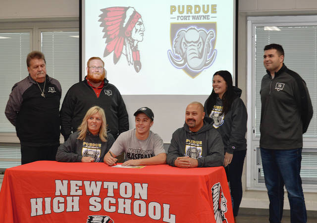 Rob Kiser|Call Photo Newton High School senior Ryan Mollette, the son of James and Tina Mollette, signs his letter of intent to play baseball for Purdue Fort Wayne as family and coaches watch.