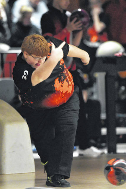 Ben Robinson|GoBuccs.com Sam Bensman rolls a strike for Versailles Saturday at Minster Community Lanes.