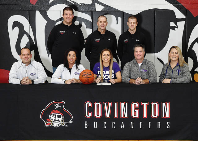 Ben Robinson|GoBuccs.com Samantha Whiteman recently signer her letter of intent to play basketball for Trevecca Nazarene University in Nashville, Tennessee. In front are Jason and Nikki Angle (mother), Whiteman and Andy (father) and Nicole Whiteman. In back are Covington girls basketball coaches Adam Sweigart, Jim Meyer and Brandon Studebaker.
