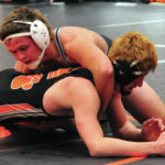 Versailles wrestlers win dual with Covington