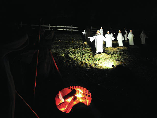 Angels appeared and told the wise men about the newborn King lying in a manger in Bethlehem, during the Stillwater Community Church live nativity on Saturday.
