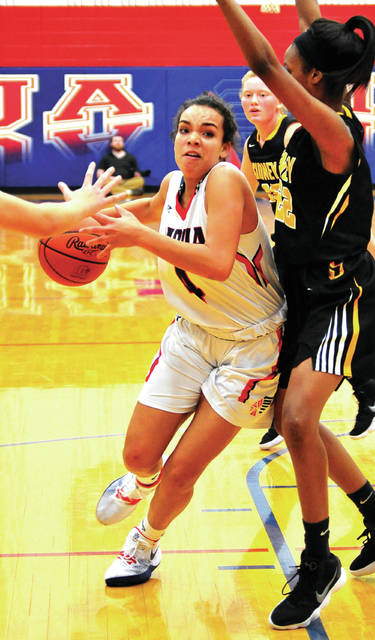 Piqua's Tylah Yeomans drives to the basket against Sidney's Samantha Reynolds Wednesday at Garbry Gymnasium.