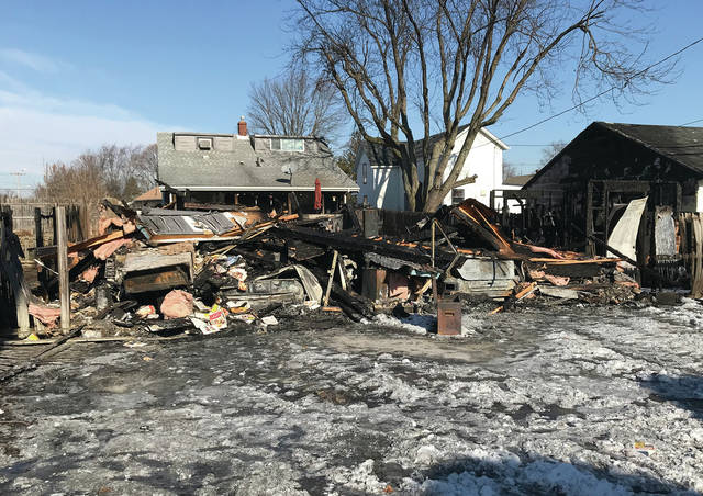 Mike Ullery | Daily Call A pile of rubble is all that remains at the scene of a garage fire at the rear of 1217 South St.