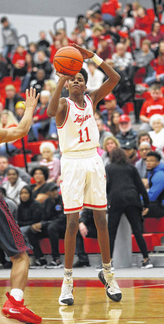 Lee Woolery|Miami Valley Sunday News Troy's Tre'Vone Archie hits one of his four 3-pointers during the Trojans' victory over Piqua Friday at the Trojan Activities Center.