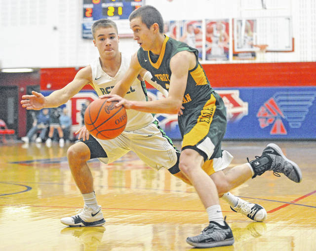 Josh Brown|Miami Valley Today Troy Christian's Izaak Frantom drives around Bethel's Nick Schmidt during the first game of the WPTW Classic tournament Thursday at Piqua High School.