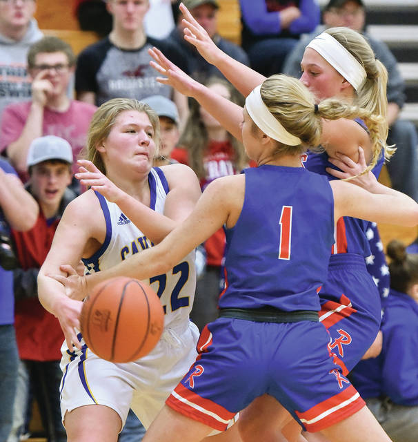 Bryant Billing|Aim Media Lehman Catholic's Emma Kennedy looks to pass with pressure from Riverside's Allison Knight, middle, and Shelby Giles, right, during a Northwest Central Conference game on Thursday iat Lehman Catholic High School.