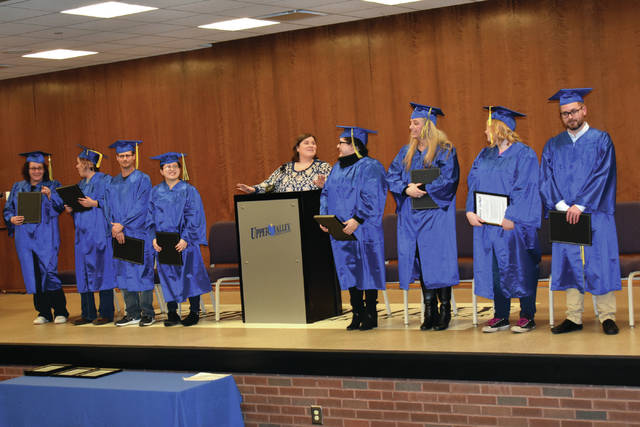 Cody Willoughby | AIM Media Midwest Aspire program director Sarah Thomason congratulates, from left, Angela Thornton, Dana Pingleton, Russell Newhouse, Angelica Negrete, Kayla Kruchkow, Christy Hilleary, Jessica Geer, and Kyle Calvert, who graduated from the program on Thursday at UVCC in Piqua.