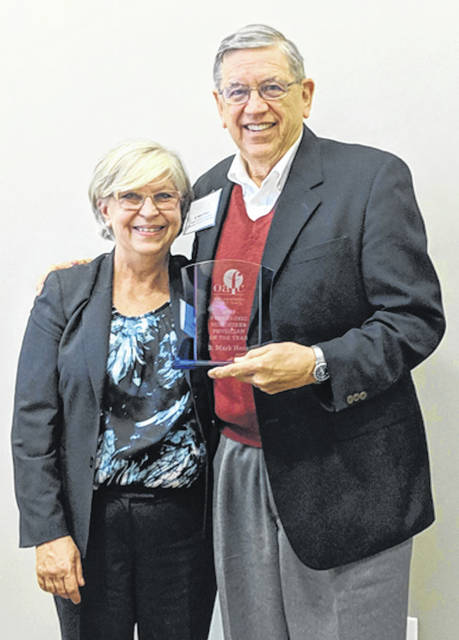 Provided photo Dr. B. Mark Hess, right, accepts his Volunteer Physician of the Year Award from Ohio Association of Free Clinics' Executive Director Deborah Miller.