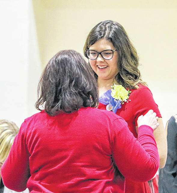 Provided photo Carly Brown, of Piqua, receives her pin from Edison State Assistant Professor of Nursing Peggy Montgomery.