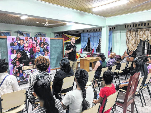 Provided photo Jeff Marconette Jr., of Piqua speaking to students in Georgetown, Guyana.