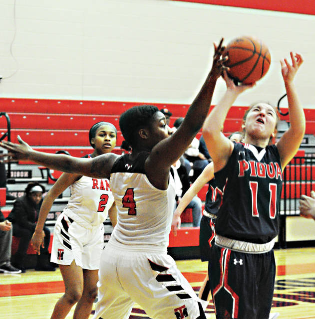 Rob Kiser|Call Photo Piqua's Andrea Marr shoots against Trotwood-Madison's Goddess McIntyre Saturday.