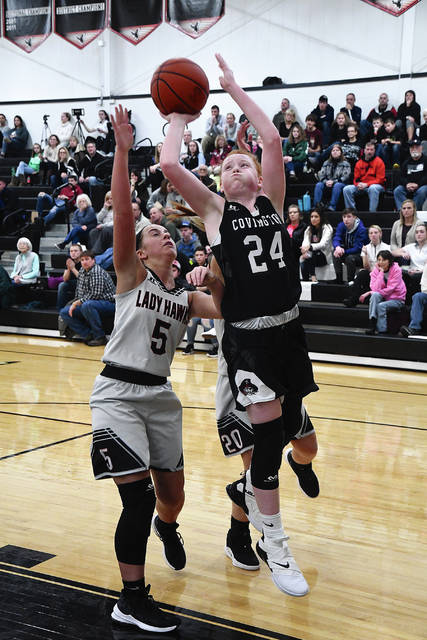 Ben Robinson|GoBuccs.com Covington's Claudia Harrington drives to the basket against Mississinawa Valley Tuesday night.