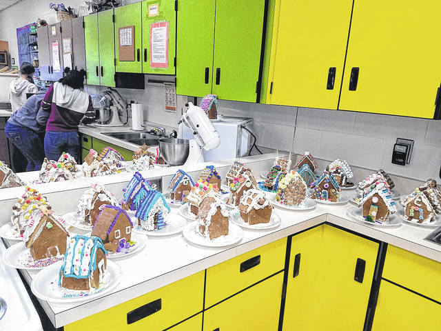Provided photo Piqua High School Culinary Fundamentals students got into the holiday spirit by working in groups to create this gingerbread village.